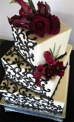 Black and White Scrolling with Maroon Flowers Wedding Cake
