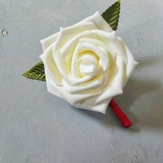 Check out this item in my Etsy shop https://www.etsy.com/listing/472024972/ivory-and-red-boutonnieres-wedding