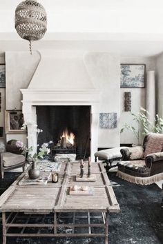 Such a cosy room. Beautiful and light for the winter but the dark floors and huge fireplace give it warmth. Love it.