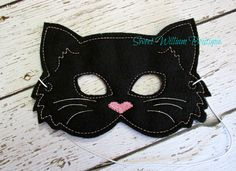 Children's black cat embroidered felt mask for dress up play, parties, or costume. (http://www.SweetWilliamBoutique.com)