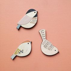 Bird brooches.