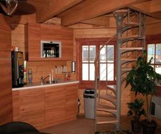 Explore this 272-square-foot log cabin and its unique octagonal pavilion design