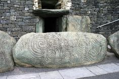 One of the most famous rocks in Ireland is the Threshold Stone standing at the entrance to Newgrange.  This megalithic stone (about 4500-5500 years old, 10 ft. by 4 ft. in size and 5 tons in weight) is elaborately carved with spirals, concentric circles and diamond shapes. The carved spiral design, though more ancient than the coming of the Celts to Ireland, was often copied by them and became one of the legendary Celtic designs.
