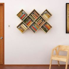 ▷ ideas and inspirations for a DIY wall shelf - regal-build-square-wall shelves-from-wood-many books-chair-door and white-wall - Diy Wall Shelves, Floating Shelves Diy, Wood Shelves, Book Wall Shelf, Shelving Ideas, Shelf Ideas, Handmade Bookshelves, Bookshelves In Bedroom, Creative Bookshelves