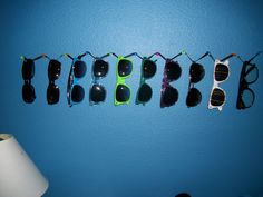 I needed a sunglasses holder but they are so expensive so I found a quick and easy DIY sunglasses holder and I made it today!!!!! I'm so happy because I have 10 sunglasses and no spot for them. And now I do!!!! All it took was some ribbon and thumbtacks! I'm happy XD!