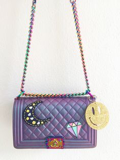 iridescent chanel bag with stoney clover sticker patches and keychain