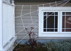 "Martha Stewart-inspired spider web made of cotton ""clothesline"" rope."