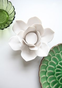 """Frosted Flower Candle Holder 19.99 at shopruche.com. Add a touch of elegance with this ceramic lotus flower candle holder in ivory.Approx. 6"""" diameter, 3"""" tall"""