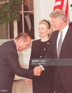 French President Jacques Chirac (L) bows, 14 June, as he greets US President Bill Clinton (R) and First Lady Hillary Clinton before a dinner at the White House in Washington, DC. Earlier, the two presidents met in the White House Oval Office and held a joint news conference. Both Chirac and Clinton are scheduled to attend the G7 summit in Halifax, Nova Scotia, which begins 15 June.