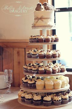 Rustic wedding cupcake tower and burlap bird toppers (cupcakes all different flavors)