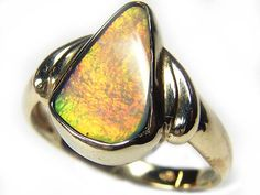 wow fire black opal ring 18k white gold size 6.5 sca 728 Opal colors are   yellows, Sunset orange, greens. It is believed that Opals increases awareness of telepathy. It is the month of October stone.An opal wearer is aided by the stone to achieve set goals.