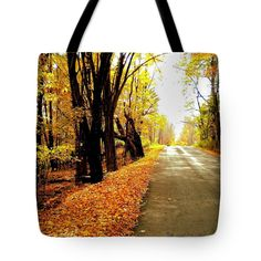 """Autumn Road Tote Bag (18"""" x 18"""") by Sand And Chi  .  The tote bag is machine washable, available in three different sizes, and includes a black strap for easy carrying on your shoulder.  All totes are available for worldwide shipping and include a money-back guarantee."""