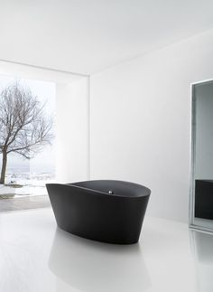 Bathroom inspiration | Bathtub TINA designed by Nacho Lavernia & Alberto Cienfuegos for Sanico | via styleandcreate.com