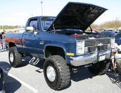 lifted blue gmc sierra truck hood open