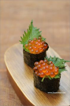 IKURA GUNKANMAKI ~~~ ikura = salmon fish roe. gunkanmaki = warship roll = a type of nigirizushi (hand pressed sushi) shaped in oval form with a vessel at the top to hold finely chopped and/or small-sized ingredients (natto, roe, oysters, scallops, corn with mayonnaise, quail eggs, etc.) [Japan] [makemysushi] [asia pacific rice dish] [sushi]