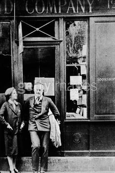 Ernest Hemingway and Syivia Beach in Paris in front of the Shakespeare Bookstore,