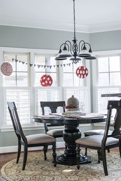 Pottery Barn metal ornament strung with bunting over table