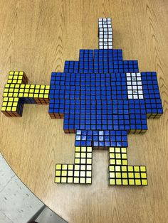 Super Mario's Bobomb made from 51 Rubik's Cubes mosaic - Click for more designs