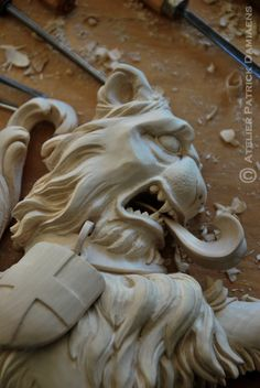 A heraldic lion | A shieldholder for familiy coat of arms |Heraldic Woodcarving | Heraldic Woodcarver