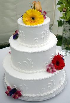 Tier Wedding Cake With Orange And Brown Ribbon And A Cascade Of