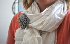 Use a fabric flower as a scarf pin- now that's a twist! by britney