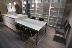 A modern retail space featuring furniture pieces designed with FENIX NTM super matte material.