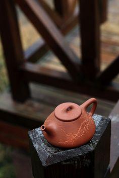 Look at that carving!  Yixing teapot from Yi Yan Cha Tang's blog