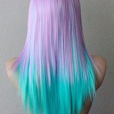 Light pastel dyed hair. Amazing lilac and bright turquoise colored tips. Ombré colour. Color.