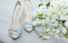 Wedding of Nicole Domakoski and Miguel Bochnia Machado Bridal Shoes and bouquet