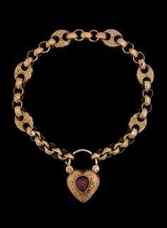 A cabochon cut garnet gold bracelet, 19th century.  14k guld. Weight 15.7 g. Original box. L. 21 cm.