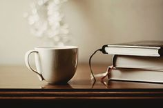I just love a pictures that contain a cup or a mug featuring with books.. it's just perfect!