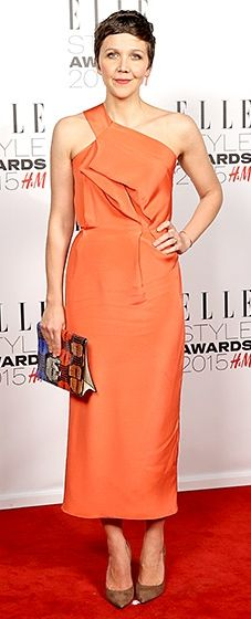 Pretty as a peach! The actress looked radiant in a bright, one-shouldered sheath and Salvatore Ferragamo pumps.