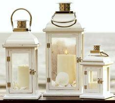 Fill Candle Lanterns with Beach Finds! Best Lanterns for Coastal Style Living… Pottery Barn Lanterns, Nautical Lanterns, Rustic Lanterns, White Lanterns, Lanterns Decor, Candle Lanterns, Candle Sconces, Decorative Lanterns, Silver Lanterns