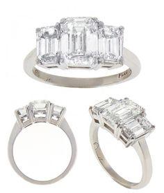 Emerald cut 3-stone Ring