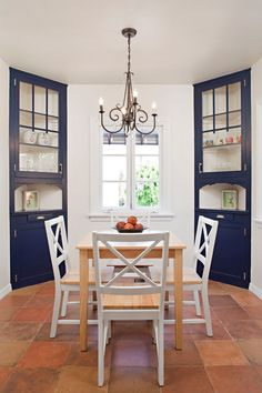 a couple of corner cabinets dining room in navy blue light toned wood dining table white finished dining chairs eathy brown tiles floors traditional pendant lamp of Corner Cabinets Dining Room, Beautiful Pieces for Your Cherished & Stylish Pieces of Dishware/ Glass Collections
