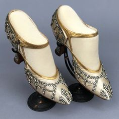 """Greco gold and rhinestone trimmed satin evening pumps. Of cream with gold leather trim having """"X"""" details at the sides, a rhinestone lattice pattern, gold straps with a dark metal 2 ½ in. Vintage Outfits, Vintage Gowns, Mode Vintage, Vintage Shoes, Vintage Fashion, 1920s Fashion Gatsby, 1920s Fashion Dresses, Fashion Moda, Fashion Shoes"""