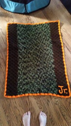 Crochet baby blanket with camo Brown an orange  yarn and used the basket stitch for my nephew..