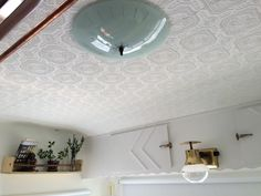 RV Ceiling wallpaper prior to painting. Our RV Remodel