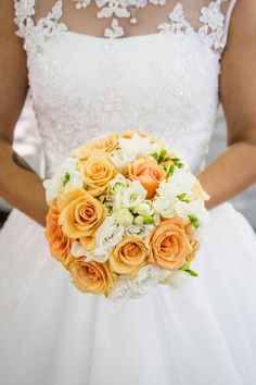 Beautiful bridal bouquet with white and orange flowers for a summer wedding  Wedding Dreamers | Wedding Directory  #weddingflowerbouquets #summerweddingflowers #orangeweddingflowers #summerweddingcolorideas