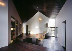 MDS designs blackened timber #house on a sloping junction in Tokyo