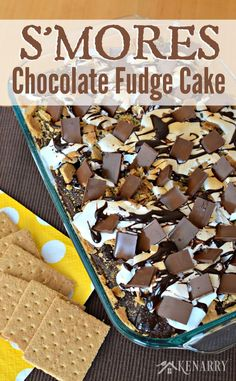 Yum! This recipe for S'mores Chocolate Fudge Cake with marshmallow and graham cracker is the next best thing to sitting by a campfire in the summer.