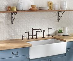 A ROHL Water appliance featuring a Shaws # Farmhouse Fireclay ...