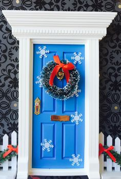 Light Blue Snowflake Fairy Door With Wreath by FairyAvenue on Etsy https://www.etsy.com/listing/212474062/light-blue-snowflake-fairy-door-with
