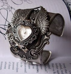 Love Gives You Wings Watch Cuff with Silver Cupid and Heart $250.00