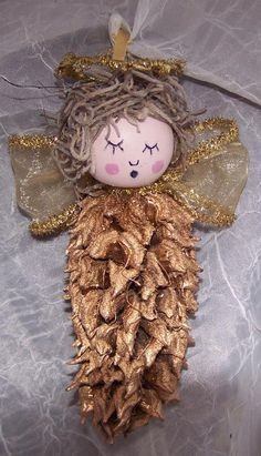 Seasonal Decorations mahnolia tree seed pod angel