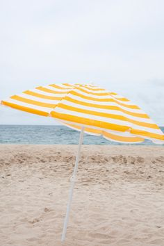 Fun yellow striped umbrella. www.withlovefromkat.com