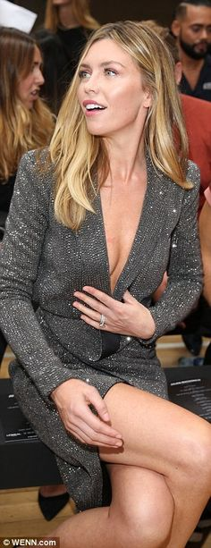 Abbey Clancy puts on a busty display at Julien Macdonald show