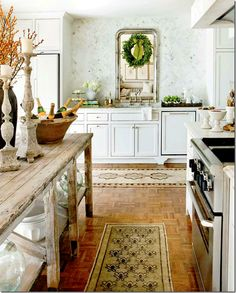 Old table top is used in this gorgeous kitchen as an island ~ champagne anyone? Love the mirror too.