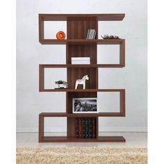 Love how they styled this - especially the white horse. Can find this bookcase on eBay