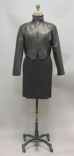 Black wool minidress ensemble (with black leather jacket), by Geoffrey Beene, American, 1987.